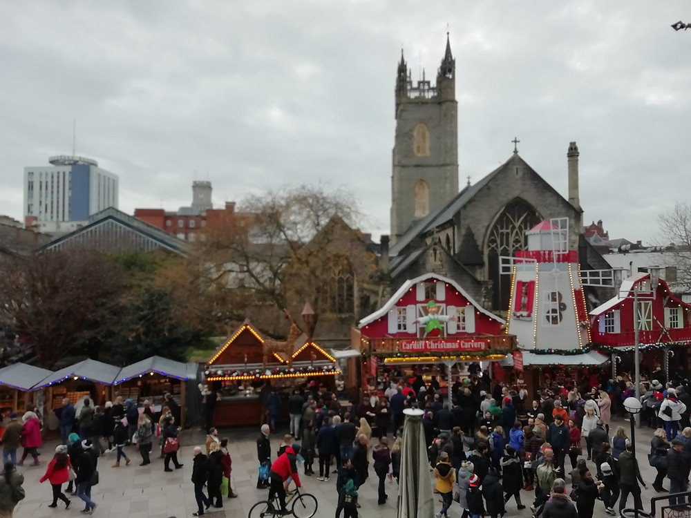 Cardiff Christmas Market takes place every year, dominating the city throughout December, like here on Working St, next to St. John's Church