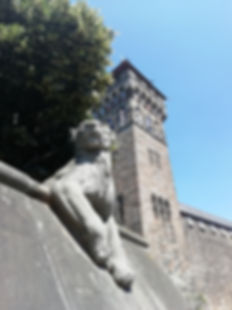 Cardiff's animal wall lioness and the Cardiff Castle clock tower