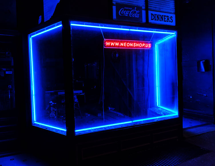 Super blue window border neon with clear red neon lettering.