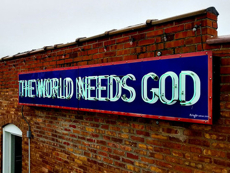 THE WORLD NEEDS GOD NEON SIGN