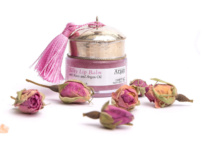 Argan Beauty - Silky Lip Balm With the active ingredients of argan, sesame and almond oils and shea butter, this slightly rose scented lip balm will keep your lips smooth and soft throughout the winter months. Argan Beauty works directly with a small manufacturing center in Morocco to ensure that are exclusively pure and organic organ oil and fragrances are used.