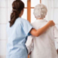 Nurse-helping-an-elderly-woman.jpg