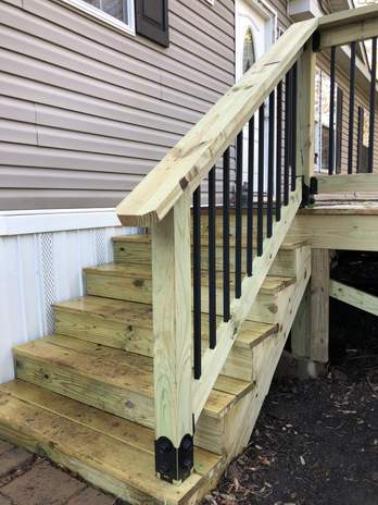 Musa Stairs on porch (1).heic