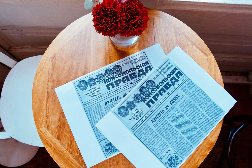 soviet newspaper red flowers on the table event agency barcelona