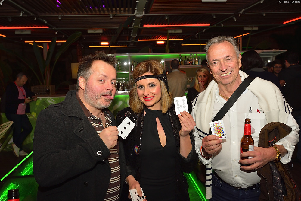 party event barcelona agency teambuilding smiling people magician cards beer