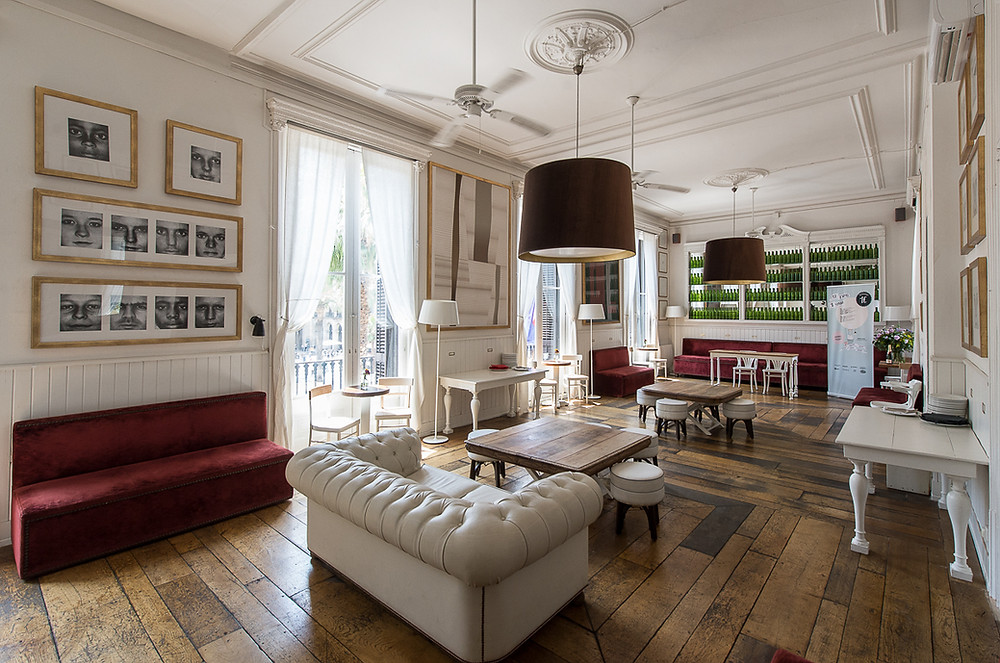 event space in barcelona white sofa big room old house