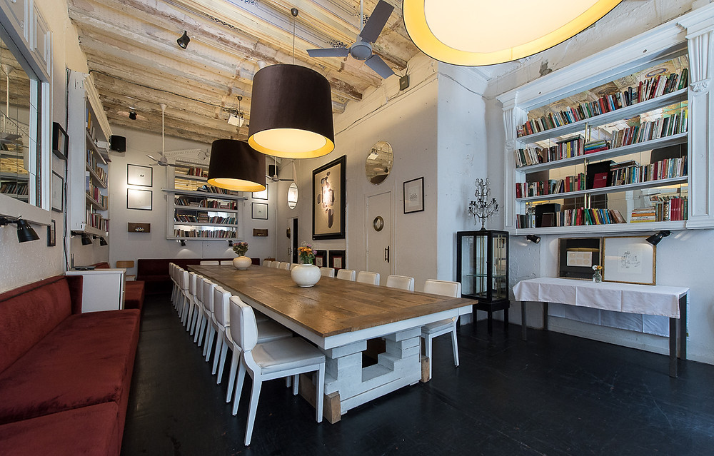 event space in barcelona white sofa books big room restaurant old house