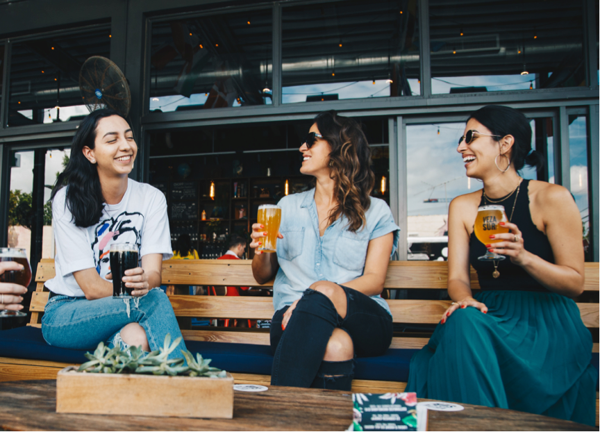 Girl friends on a summer terrace having fun drinking event agency barcelona beers