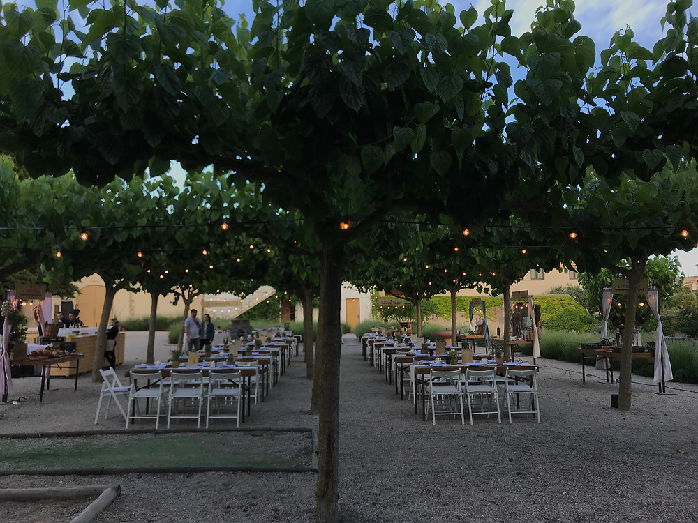 outdoor venue event tables chairs lights sunset garden outside barcelona