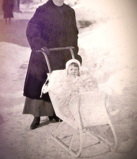 Baby in Snow Carriage