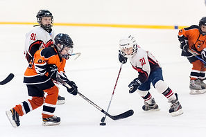 Game between children ice-hockey teams.j