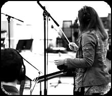Kate Diaz orchestra conducting original music at Berklee