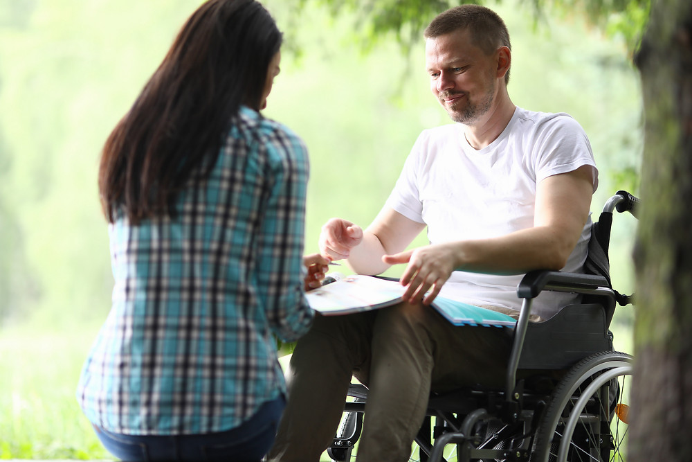 disabled_man_and_woman_talking_outside