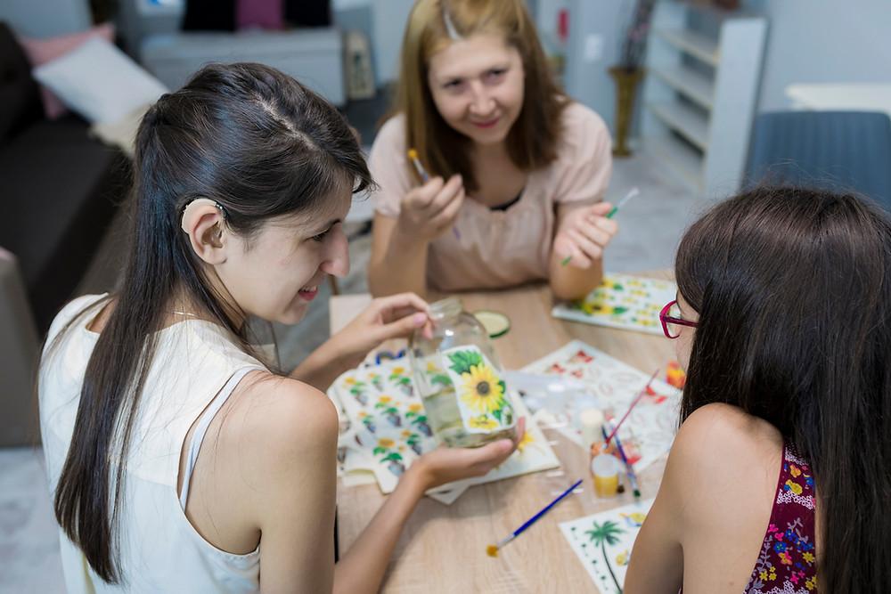 group-of-women-in-an-art-class-decorating-glass-jars-ndis-goals