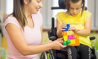 Lady helping girl in wheelchair, NDIS software