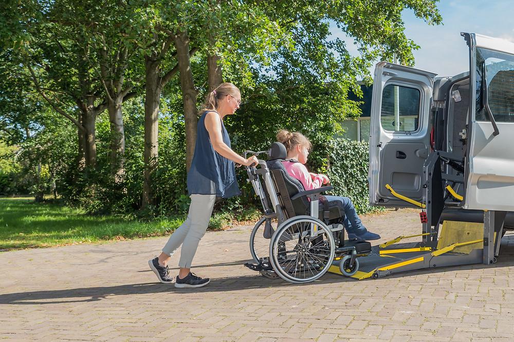 disable-girl-carer-transport-disability.jpeg