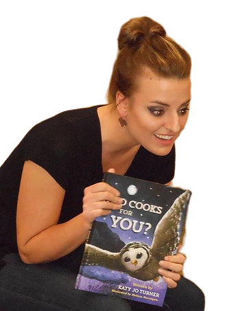 "Photo of author Katy Jo Turner holding up her children's book ""Who Cooks for You?"""