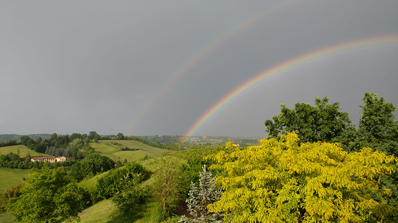 Double rainbow over Asti seen from balcony