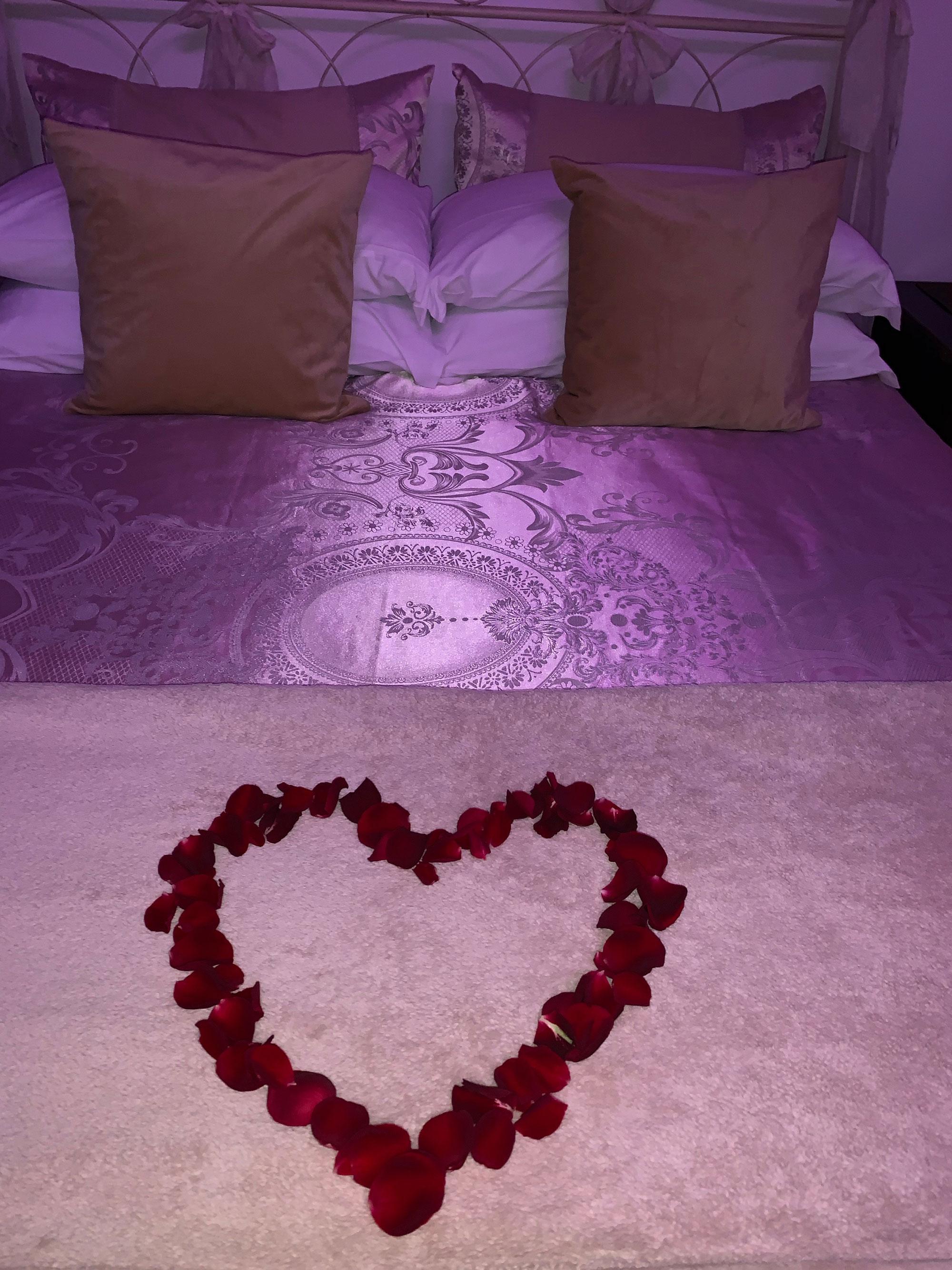 romantic getaway rose petal heart