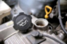 closeup engine oil cap in engine room of