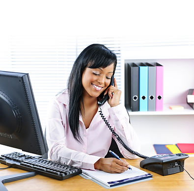 Smiling young black business woman on ph