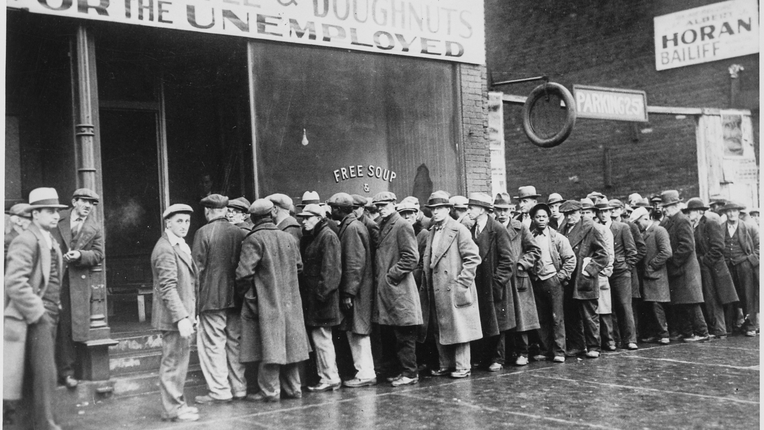Unemployed men queued outside a depression soup kitchen in Chicago 1931