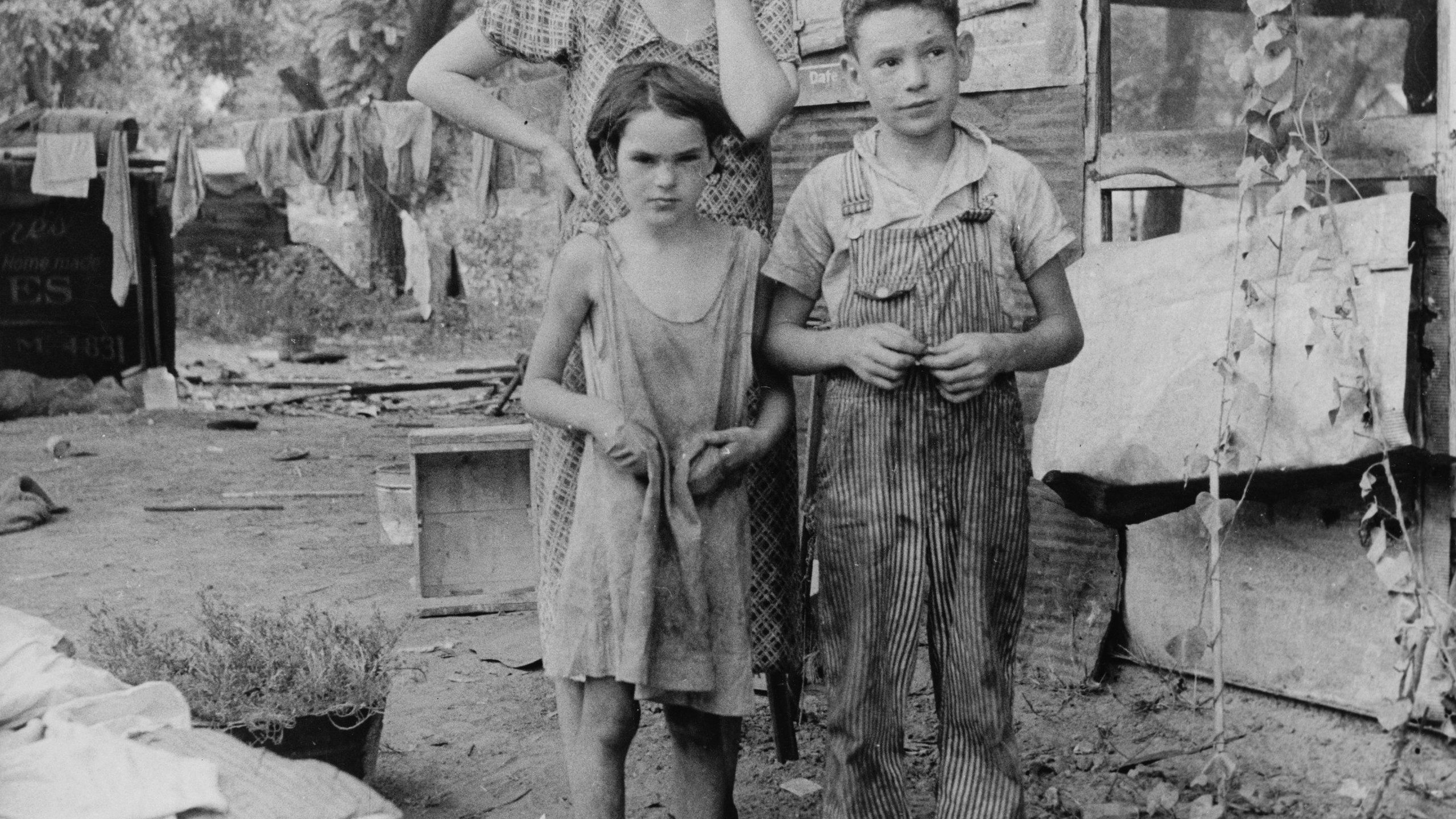 An impoverished American family living in a shanty, 1936