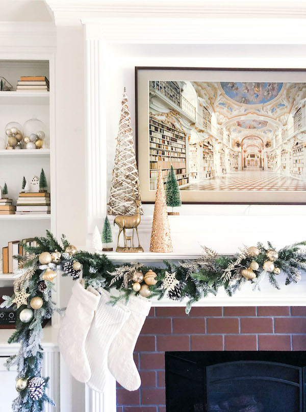 neutral white and gold christmas fireplace mantle