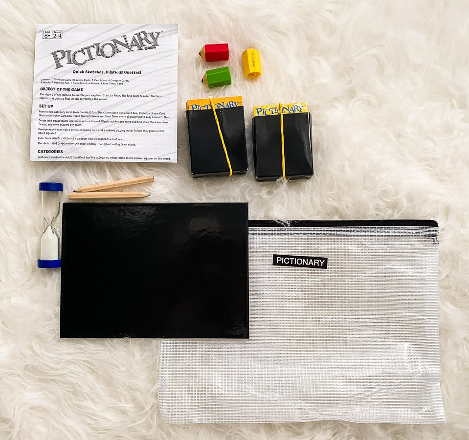 reorganizing board games into reusable bags- pictionary