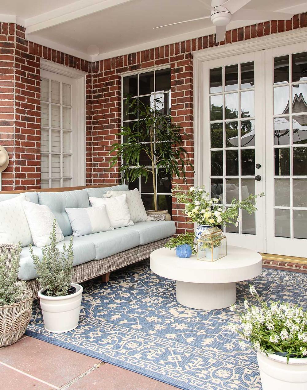 cindy crawford hamptons cove sofa mist, blue outdoor rug, backyard makeover