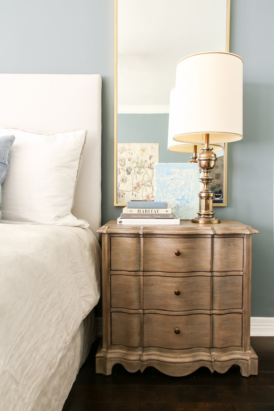 styled nightstand with brass lamp grandmillenial