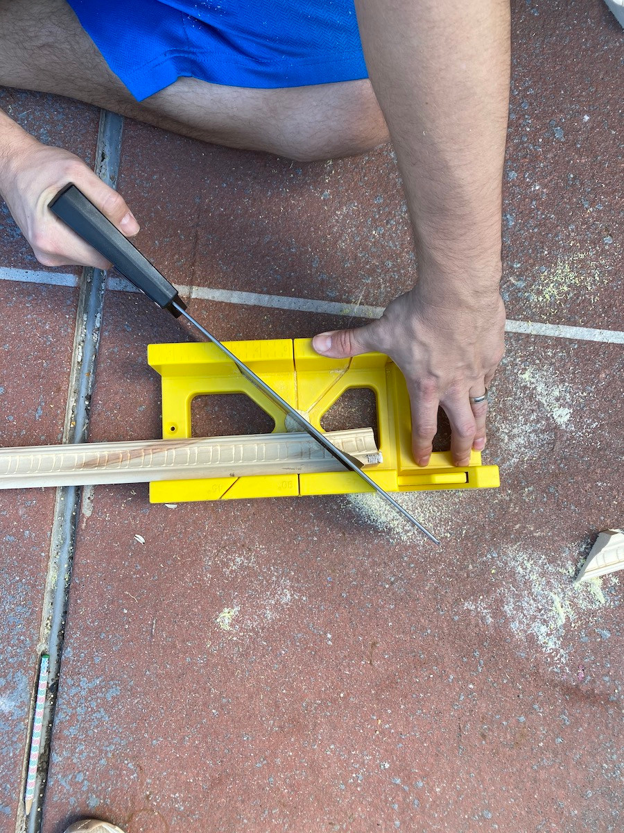 using a miter box and hand saw
