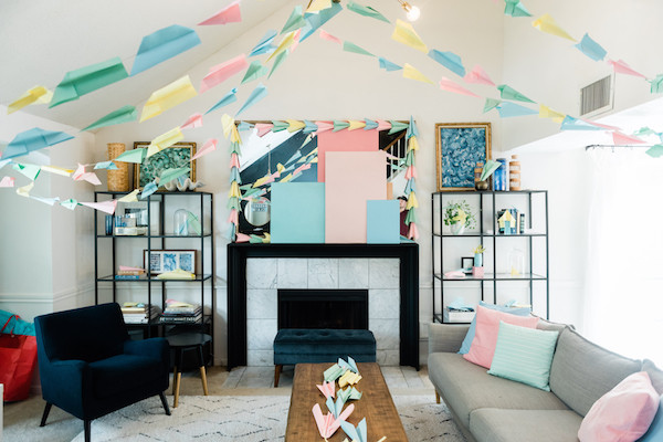 paper airplane kid party ideas- paper airplane ceiling installation