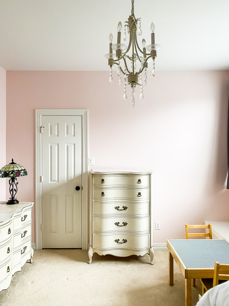 pink room with chandelier