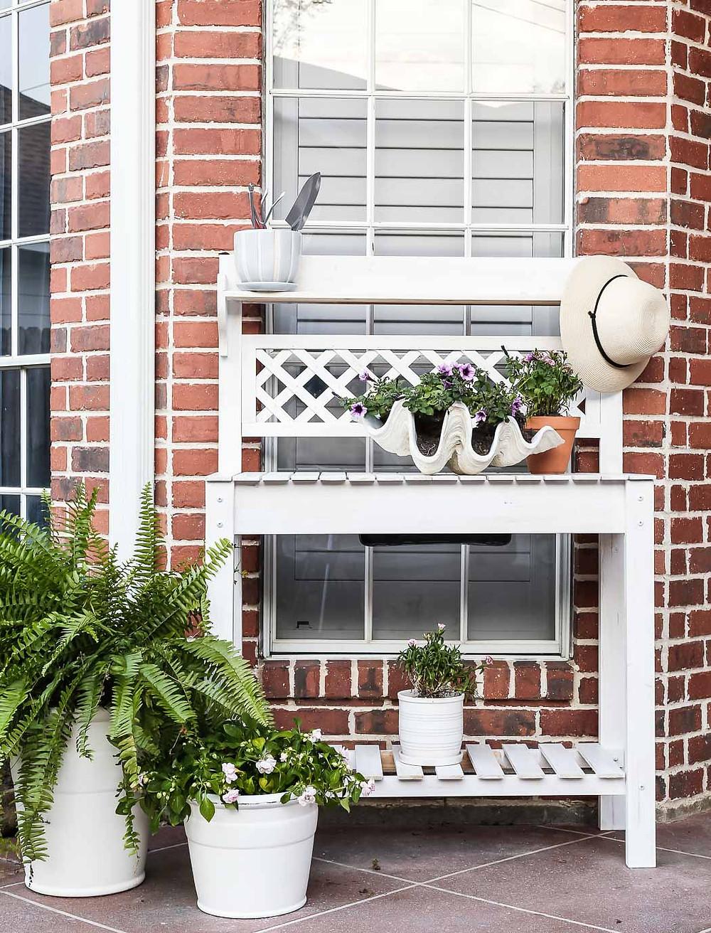 pretty lattice white garden workstation, clamshell planter