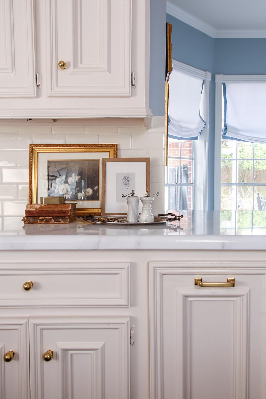 aged brass rejuvenation drawer pull, white and marble kitchen