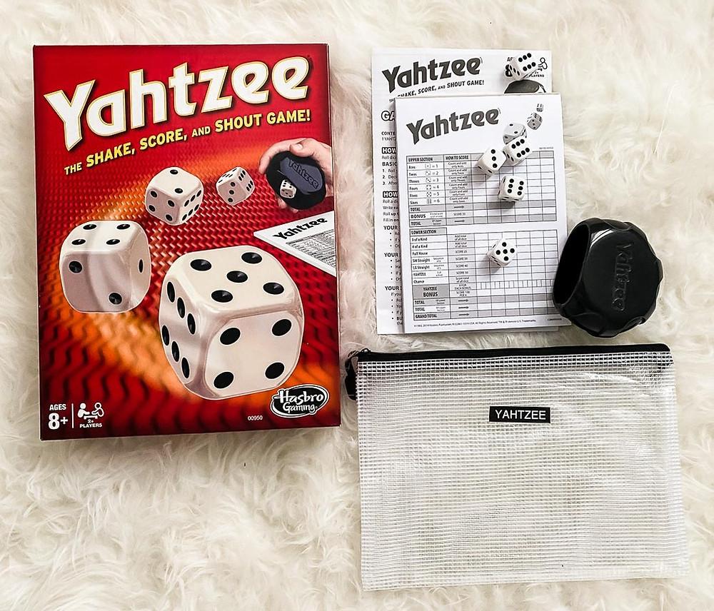 reorganizing board games into reusable bags- yahtzee