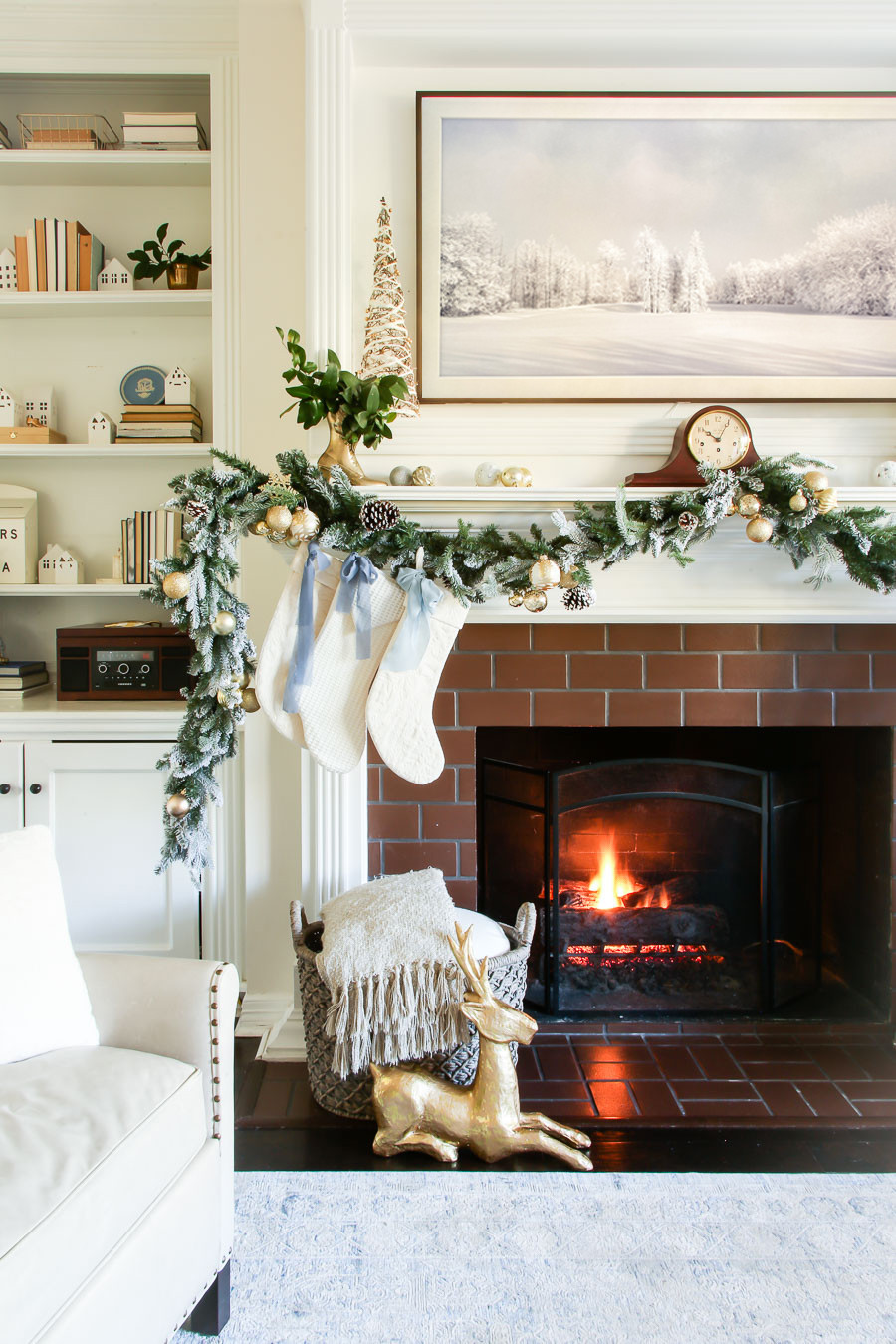 neutral and gold Christmas fireplace mantel with blue bows