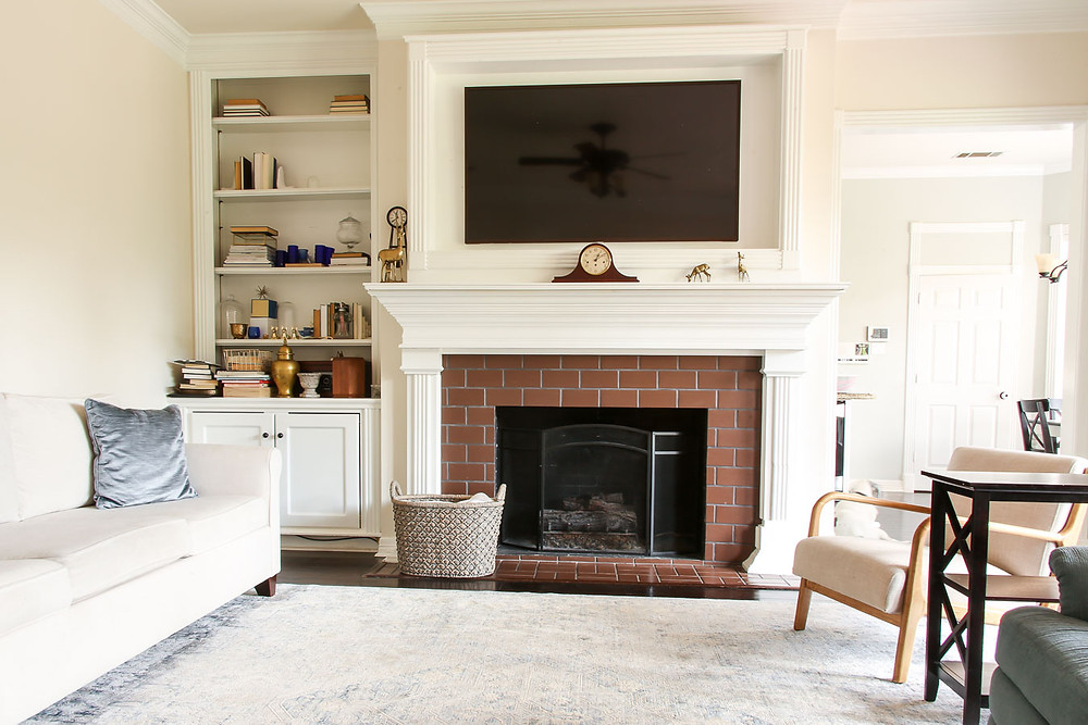 white fireplace with brown brick