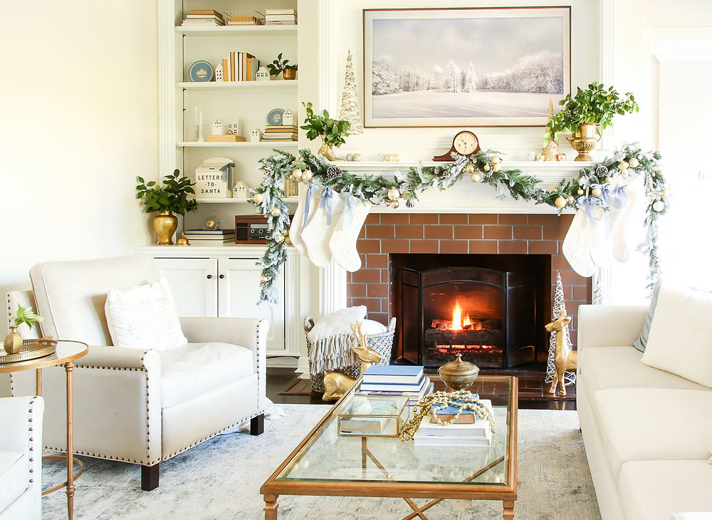 Jennifer Laura Living | neutral and gold Christmas fireplace mantel with blue bows.