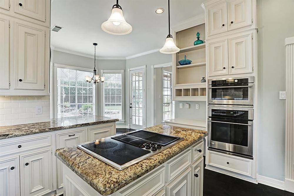 white kitchen and tan granite countertops