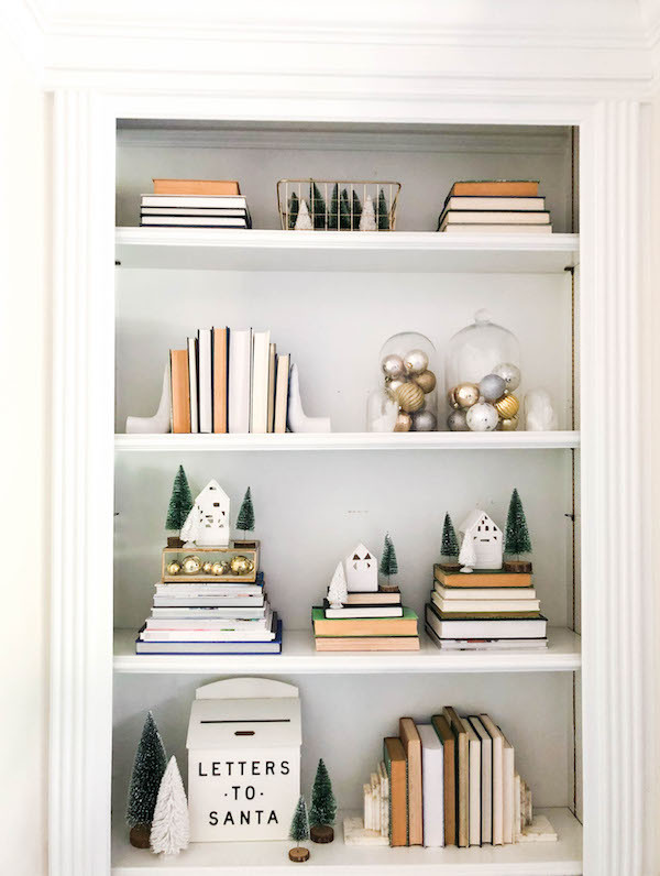 neutral white and gold christmas shelf