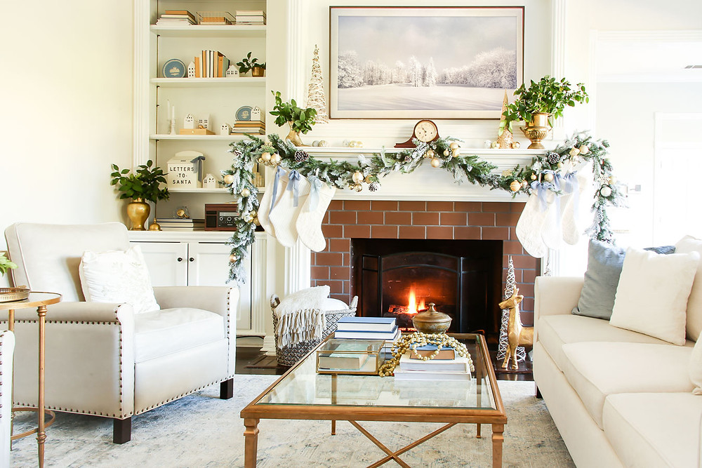 neutral and gold christmas living room and fireplace, blue bows