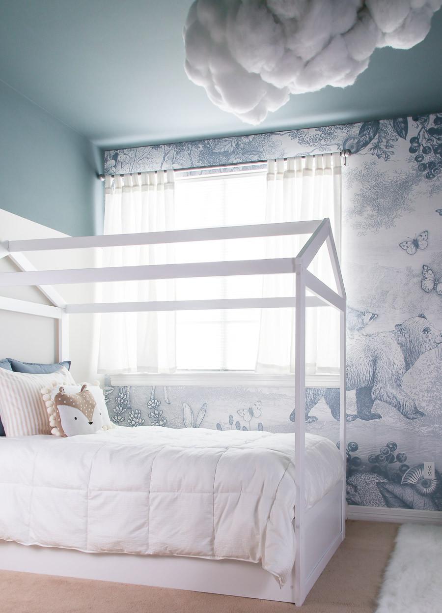 blue woodland kids room and kids frame bed