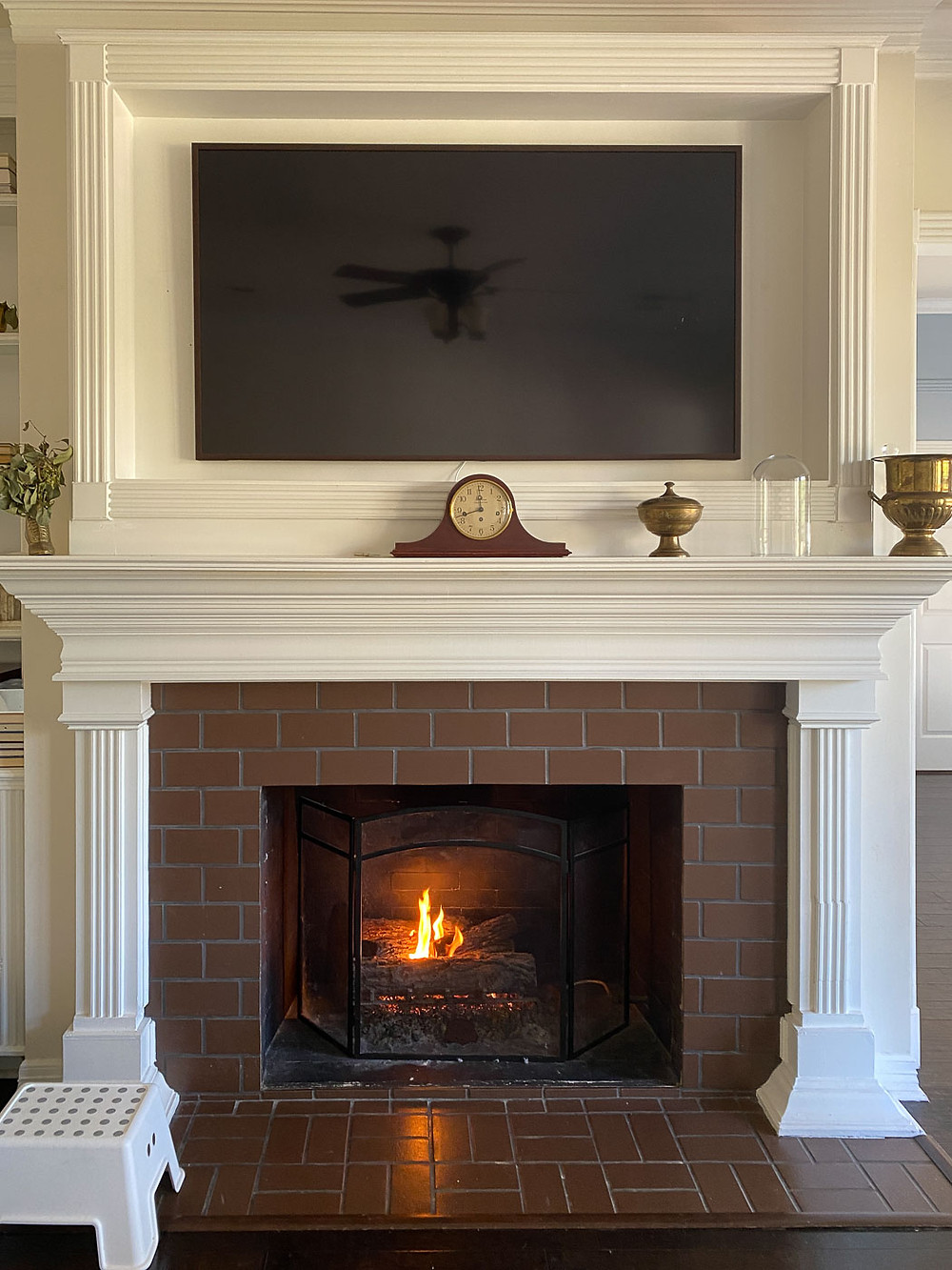 white fireplace and mantle with brick