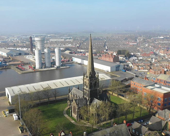 Goole Parish Church with the 'Salt and Pepper pots' water towers in the background
