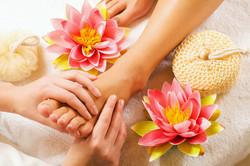 Foot massage by reflexologist