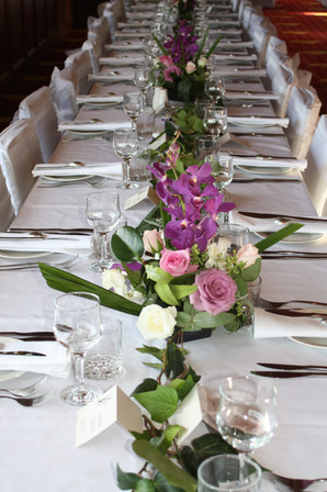 Mundoo Wedding floral centre pieces.jpg