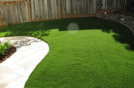Walkway by perfect lawn
