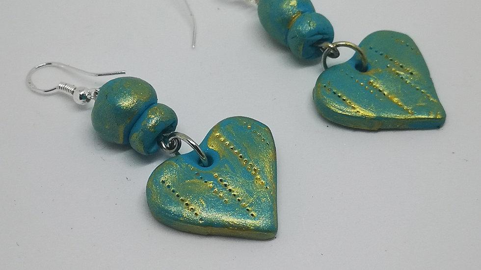 Handmade clay heart drop earrings.